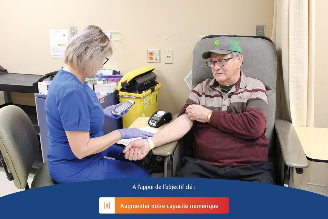A registered nurse at Health Sciences North displays a MobiLab